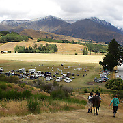 A competitor heads back to the competition arena during the Cross Country event at the Wakatipu One Day Horse Trials at the Pony Club grounds,  Queenstown, Otago, New Zealand. 15th January 2012. Photo Tim Clayton