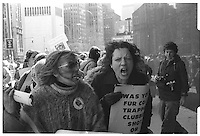 """Protest march against fur with sign:""""Was your fur coat, trapped, clubbed, shot or gassed?"""". Street photography. 1980"""