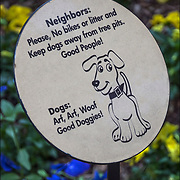 """Sign """"Neighbors: Please, No bikes or litter and Keep dogs away from tree pits. Good People! Dogs: Arf, Art, Woof Good Doggies!"""""""