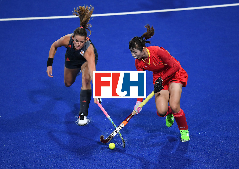 Netherland's Lidewij Welten vies for the ball with China's Sun Xiao during the women's field hockey China vs Netherlands match of the Rio 2016 Olympics Games at the Olympic Hockey Centre in Rio de Janeiro on August, 10 2016. / AFP / MANAN VATSYAYANA        (Photo credit should read MANAN VATSYAYANA/AFP/Getty Images)