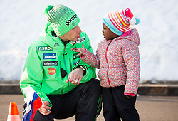 Robert Kranjec of Slovenia with his daughter Pika waiting for a helicopter drive to Planica from Kranjska Gora prior to the Ski Flying Hill Individual Competition at Day 4 of FIS Ski Jumping World Cup Final 2016, on March 20, 2016 in Planica, Slovenia. Photo by Vid Ponikvar / Sportida