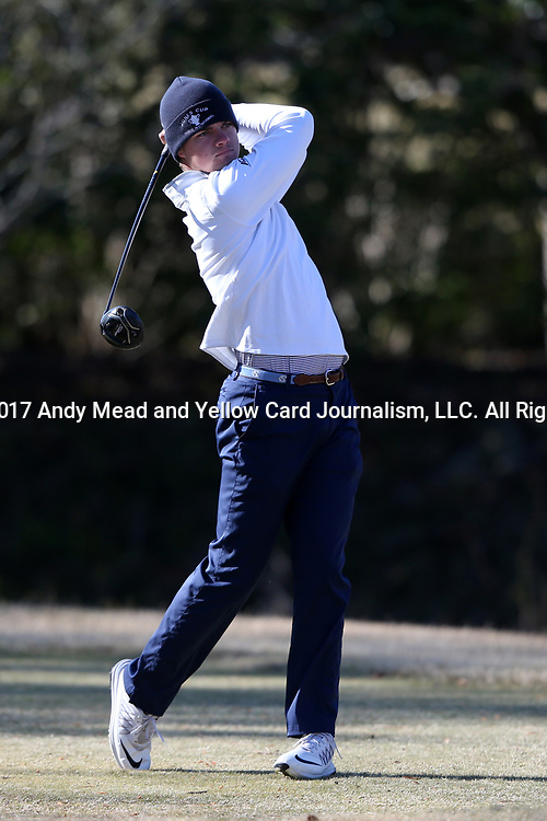 WILMINGTON, NC - MARCH 19: North Carolina's Austin Hitt tees off on the Ocean Course fifth hole. The first round of the 2017 Seahawk Intercollegiate Men's Golf Tournament was held on March 19, 2017, at the Country Club of Landover Nicklaus Course in Wilmington, NC.