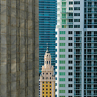 Historic Freedom Tower, Miami, surrounded by highrise condos. Historic Freedom Tower, Miami surrounded by highrise condos being developed.
