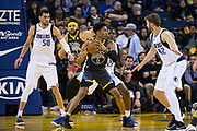 Golden State Warriors guard Patrick McCaw (0) looks for an open teammate against the Dallas Mavericks at Oracle Arena in Oakland, California, on February 8, 2018. (Stan Olszewski/Special to S.F. Examiner)