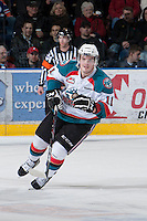 KELOWNA, CANADA - JANUARY 24: Carter Rigby #11 of the Kelowna Rockets skates on the ice against the  Seattle Thunderbirds at the Kelowna Rockets on January 24, 2013 at Prospera Place in Kelowna, British Columbia, Canada (Photo by Marissa Baecker/Shoot the Breeze) *** Local Caption ***