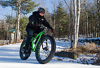 "Sonya Misiaszek gets in a ""lunch hour"" workout on her fat bike with Kale Poland at Gunstock Nordic on Thursday.  (Karen Bobotas/for the Laconia Daily Sun)"