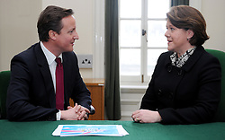 Leader of the Conservative Party David Cameron with Maria Miller. Member of Parliament for Basingstoke in his office in Norman Shaw South, January 7, 2010. Photo By Andrew Parsons / i-Images.<br />