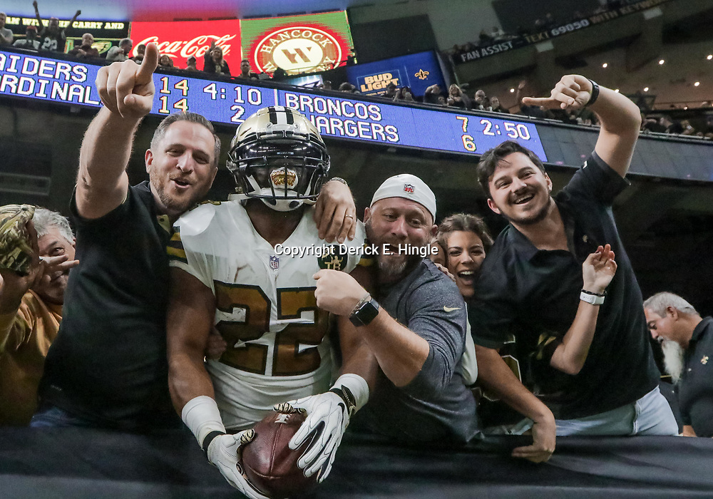 Nov 18, 2018; New Orleans, LA, USA; New Orleans Saints running back Mark Ingram II (22) celebrates in the stands with fans following a touchdown run against the Philadelphia Eagles during the second quarter at the Mercedes-Benz Superdome. Mandatory Credit: Derick E. Hingle-USA TODAY Sports
