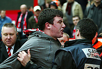 Photo: Chris Ratcliffe.<br /> <br /> Charlton Athletic v Brentford. The FA Cup. 18/02/2006.<br /> <br /> A Brentford Fan is ejected from the ground after landing on the photographers!