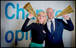 Sun Editor David Dinsmore with Kris Hallenga from CoppaFeel with her Innovation Award and her Campaign of the Year award at the Westbourne Communication Change Opinion Awards, London, United Kingdom. Thursday, 15th May 2014. Picture by Andrew Parsons / i-Images