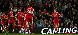 11.01.2012, Etihad Stadion, Manchester, ENG, Carling Cup, Manchester City vs FC Liverpool, Halbfinale, im Bild Liverpool's captain Steven Gerrard celebrates scoring the first goal against Manchester City from the penalty spot with team-mates during the football match of English Carling Cup, Halffinal, between Manchester City and FC Liverpool at Etihad Stadium, Manchester, United Kingdom on 2012/01/11. EXPA Pictures © 2012, PhotoCredit: EXPA/ Propagandaphoto/ David Rawcliff..***** ATTENTION - OUT OF ENG, GBR, UK *****