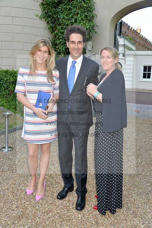 Left to right, KATIE ELLIOT, YOUNES ZRIKEM and LAURA PARKER-BOWLES at the Quintessentially Foundation and Elephant Family 's 'Travels to My Elephant' Royal Rickshaw Auction presented by Selfridges and hosted by HRH The Prince of Wales and The Duchess of Cornwall held at Lancaster House, Cleveland Row, St.James's, London on 30th June 2015.
