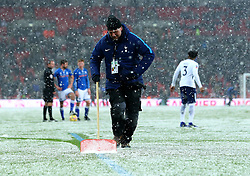 Ground staff try to clear snow from the Wembley pitch during the second half of The FA Cup tie between Tottenham Hotspur and Rochdale - Mandatory by-line: Robbie Stephenson/JMP - 28/02/2018 - FOOTBALL - Wembley Stadium - London, England - Tottenham Hotspur v Rochdale - Emirates FA Cup fifth round proper