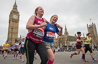 Runners pass through Parliament Square with Big Ben in Background. The Virgin Money London Marathon, Sunday 26th April 2015.<br /> <br /> Photo: Paul Gregory for Virgin Money London Marathon<br /> <br /> For more information please contact Penny Dain at pennyd@london-marathon.co.uk