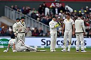 Joe Root of England sits on the ground as Tim Paine of Australia asks for an lbw review against the England captain during the International Test Match 2019, fourth test, day three match between England and Australia at Old Trafford, Manchester, England on 6 September 2019.