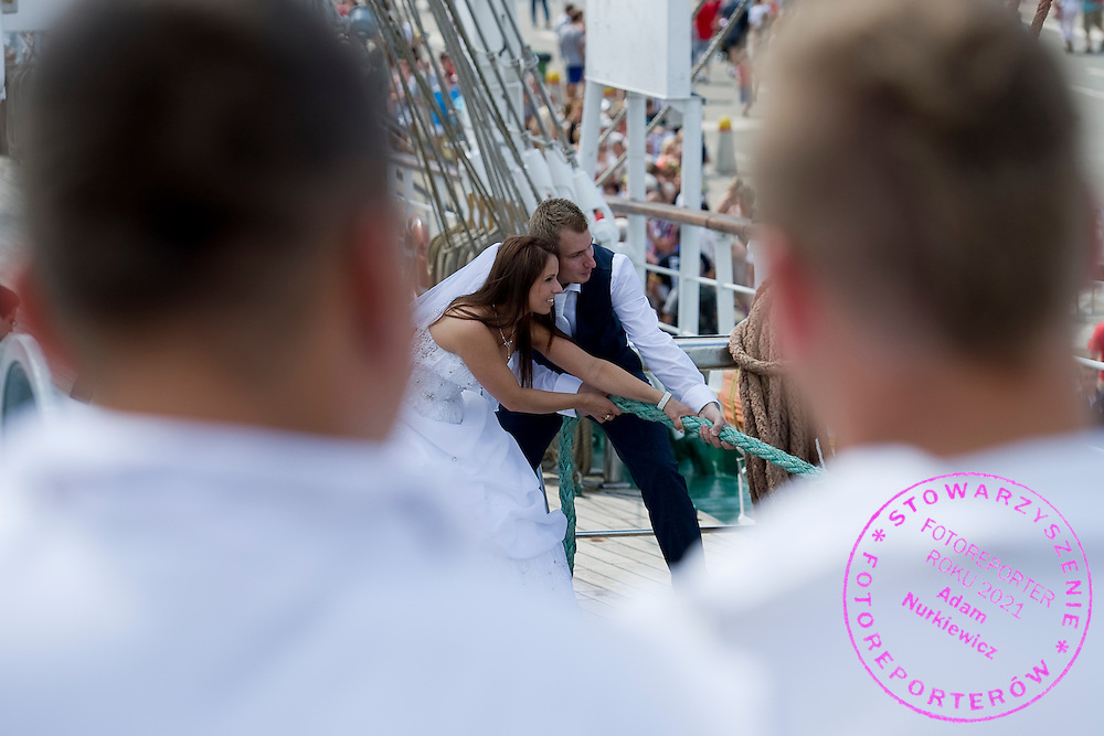 Wedding photo session during The Tall Ships Races 2013 on Odra River in Szczecin, Poland.<br /> <br /> Poland, Szczecin, August 05, 2013<br /> <br /> Picture also available in RAW (NEF) or TIFF format on special request.<br /> <br /> For editorial use only. Any commercial or promotional use requires permission.<br /> <br /> Mandatory credit:<br /> Photo by © Adam Nurkiewicz / Mediasport