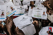 Haitian immigrants hoping to register in the national regularization plan show their birth certificates issued by the Haitian embassy in the Dominican Republic.