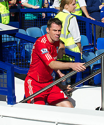 LIVERPOOL, ENGLAND - Saturday, October 1, 2011: Liverpool's Jamie Carragher walks out to face Everton during the Premiership match at Goodison Park. (Pic by David Rawcliffe/Propaganda)