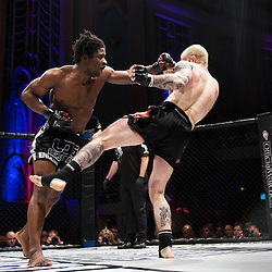 GALORE BOFANDO TAKES A SHOT AT PETER IRVING WHILE PETER GOES FOR A SIDE KICK - UCMMA 34 2 JUNE 2013