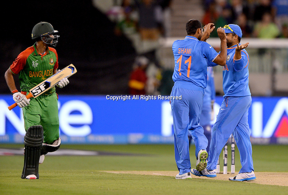 MD Shami (Ind) gets the wicket of MD Mahmud Ullah (Bang)<br /> India vs Bangladesh / Qtr Final 2<br /> 2015 ICC Cricket World Cup<br /> MCG / Melbourne Cricket Ground <br /> Melbourne Victoria Australia<br /> Thursday 19 March 2015<br /> &copy; Sport the library / Jeff Crow