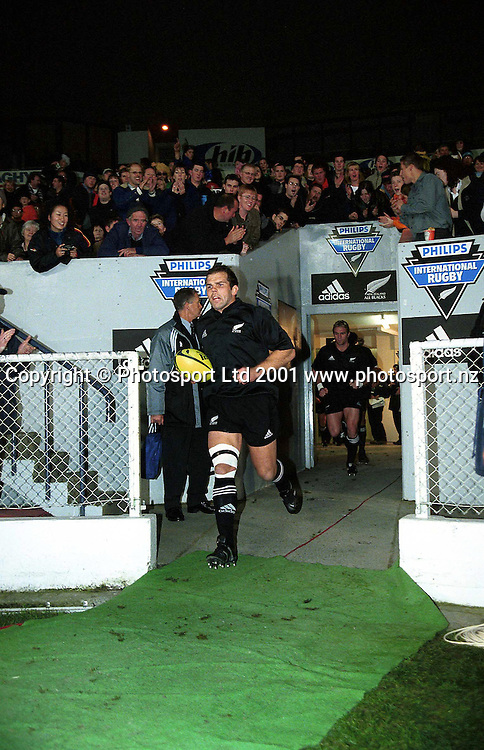 Anton Oliver leads the All Blacks out for the rugby union match between the All Blacks and Argentina Pumas, 23 June, 2001, Jade Stadium, Christchurch, New Zealand.<br /> All Blacks defeated Argentina 67-19. Photo: Sandra Teddy/Photosport.co.nz
