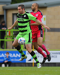 Forest Green Rovers's Jonathan Parkin and  Dover Athletic's Richard Orlu challenge for the high ball  - Photo mandatory by-line: Nizaam Jones - Mobile: 07966 386802 - 25/04/2015 - SPORT - Football - Nailsworth - The New Lawn - Forest Green Rovers v Dover - Vanarama Conference League