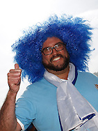 A Uruguay fan with big blue wig during the 2014 FIFA World Cup last 16 match at Maracana Stadium, Rio de Janeiro, Brazil.<br /> Picture by Andrew Tobin/Focus Images Ltd +44 7710 761829<br /> 28/06/2014