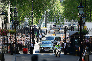 © Licensed to London News Pictures. 24/07/2012. Westminster, UK The Queen arrives in Downing Street. The British Prime Minister David Cameron hosts a lunch today 24th July 2012 at Downing Street for HM The Queen and the Duke of Edinburgh with the Deputy Prime Minister and past Prime Ministers, Sir John Major, Tony Blair and Gordon Brown. Photo credit : Stephen Simpson/LNP