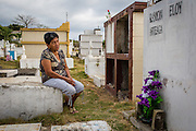 "2016/10/09 – Jama, Ecuador: Zoila Alciva, 78, visits her husband grave on the Jama cemetery, Ecuador., 9th October 2016. Her husband passed away after he was trapped between collapsing walls of their house during the 16th April earthquake. ""He was unable to escape because he was on a wheel chair"" says Zoila. She is critic of the Government because she didn't got any help; all the help came from family and friends. (Eduardo Leal)"