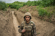 A member of the armed forces of Nagorno-Karabakh at their post along the line of contact with Azerbaijani forces in the eastern direction on April 21, 2015 near the town of Agdam, Nagorno-Karabakh. Since signing a ceasefire in a war with Azerbaijan in 1994, Nagorno-Karabakh, officially part of Azerbaijan, has functioned as a self-declared independent republic and de facto part of Armenia, with hostilities along the line of contact between Nagorno-Karabakh and Azerbaijan occasionally flaring up and causing casualties.