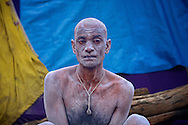 An Ash smeared Naga Sadhu who was recently converted to Naga Sadhu status. Naga Sadhus belong to the Shaiva sect, they have matted locks of hair and their bodies are covered in ashes like Lord Shiva.<br /> <br /> Kumbh Mela, 2010, Haridwar, Uttarakhand.