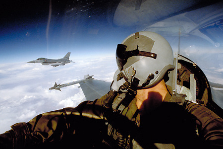 """F-16D Fighting Falcon of the 614th TFS """"Lucky Devils"""" over the Persian Gulf on a strike mission to bomb Iraqi tank battlements on the front lines in Kuwait during Operation Desert Storm.."""