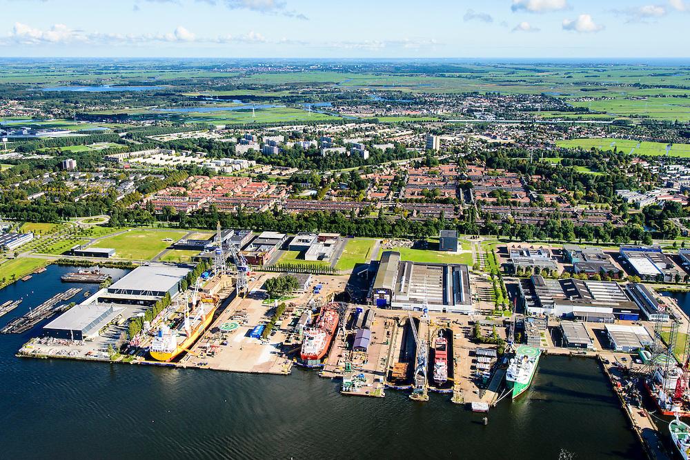 Nederland, Noord-Holland, Amsterdam, 27-09-2015;<br /> Amsterdam-Noord, NDSM-werf, westelijk deel met Droogdokken voor scheepsreparatie op de scheepswerf van Shipdock (Amsterdam Ship Repair). Terrein oorspronkelijk van ADM (Amsterdamse Droogdok Maatschappij) of NDM (Nederlandse Dok Maatschappij). Stadsontwikkelinggebied.<br /> Amsterdam-North, dry docks for ship repair at the shipyard Shipdock. Urban development.<br /> luchtfoto (toeslag op standard tarieven);<br /> aerial photo (additional fee required);<br /> copyright foto/photo Siebe Swart