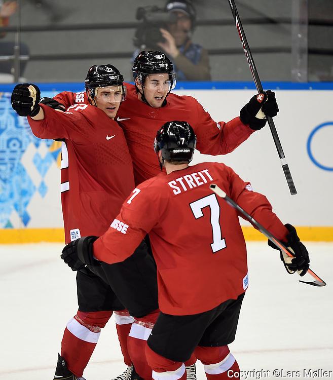 DK Caption: <br /> 20140212, Sochi, Rusland:  Vinter Olympiske Lege/Vinter OL i Sochi 2014: Isheckey herrer, Letland - Schweiz:  Simon Moser, Schweiz, Switzerland har scoret til 1-0<br /> Foto: Lars M&oslash;ller<br /> UK Caption: <br /> 20140212, Sochi, Russia:  Sochi 2014 Winter Olympic Games: Icehockey Men, Latvia - Switzerland: Simon Moser, Schweiz, Switzerland has scoret to 1-0<br /> Photo: Lars Moeller