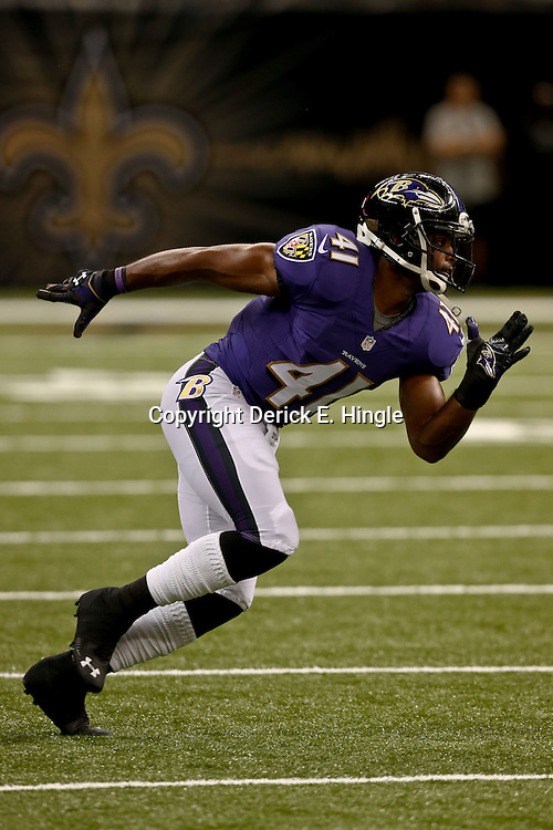 Aug 28, 2014; New Orleans, LA, USA; Baltimore Ravens defensive back Anthony Levine (41) warms up before a preseason game against the New Orleans Saints at Mercedes-Benz Superdome. The Ravens defeated the Saints 22-13. Mandatory Credit: Derick E. Hingle-USA TODAY Sports