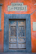 A door facing the street leading to the city center of San Miguel de Allende, Mexico.