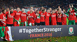 CARDIFF, WALES - Tuesday, October 13, 2015: Wales players celebrate qualifying for the finals after a 2-0 victory over Andorra during the final UEFA Euro 2016 qualifying Group B match at the Cardiff City Stadium. Joe Allen, Joe Ledley, Chris Gunter, Gareth Bale, Aaron Ramsey, Neil Taylor, Ben Davies, Tom Lawrence, David Edwards. (Pic by Barry Coombs/Propaganda)