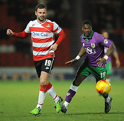 Bristol City's Kieran Agard chases down Doncaster Rovers' Richard Wellens - Photo mandatory by-line: Dougie Allward/JMP - Mobile: 07966 386802 - 24/02/2015 - SPORT - Football - Doncaster - Keepmoat Stadium - Doncaster Rovers v Bristol City - Sky Bet League One