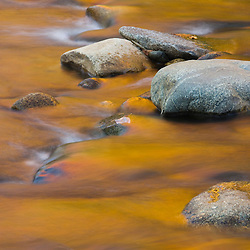 Fall colors reflect in the Israel River in New Hampshire's White Mountains.