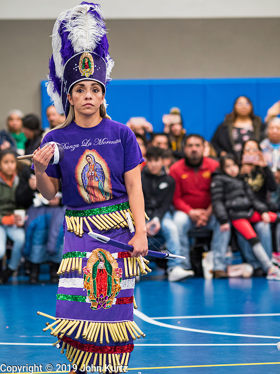 11 DECEMBER 2019 - DES MOINES, IOWA: A dancer with Danza La Morenita performs during the Virgin of Guadalupe celebration at Our Lady of the Americas Catholic Church in Des Moines. Virgin of Guadalupe Day is one of the most important holy days in Mexican Catholicism. It marks Dec. 12, 1531, the day Juan Diego, an indigenous Mexican peasant, saw an apparition of the Virgin Mary on a barren hillside in what is now Mexico City. A basilica was built on the site. Virgin of Guadalupe Day is celebrated throughout Mexico and in Mexican communities in the United States.               PHOTO BY JACK KURTZ