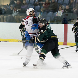KINGSTON, ON - MAR 9,  2017: Ontario Junior Hockey League, playoff game between the Cobourg Cougars and Kingston Voyageurs, Reade MacInnis #2 of the Cobourg Cougars makes the hit on Danny Reidel #19 of the Kingston Voyageurs during the 1st period.<br /> (Photo by Ian Dixon/ OJHL Images)