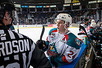 KELOWNA, BC - FEBRUARY 16: Kyle Topping #24 of the Kelowna Rockets leans on the boards at the bench and speaks to ice officials during a time out against the Vancouver Giants at Prospera Place on February 16, 2019 in Kelowna, Canada. (Photo by Marissa Baecker/Getty Images)