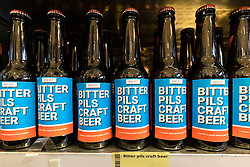 © Licensed to London News Pictures. 23/11/2018. London, UK.  'Bitter Pils Craft Beer' on a shelf inside the People's Vote campaign stunt pop-up shop in Peckham High Street on Black Friday to show that the government's Brexit deal is a bad deal and the shop is stocked with household products, such as 'chlorinated' chicken to illustrate the bad deal. Photo credit: Vickie Flores/LNP