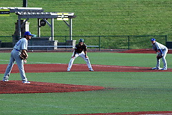 03 June 2016:  Aaron takes a lead from first base and baseman Blair Beck with Jake Fisher on the mound during a Frontier League Baseball game between the Windy City Thunderbolts and the Normal CornBelters at Corn Crib Stadium on the campus of Heartland Community College in Normal Illinois