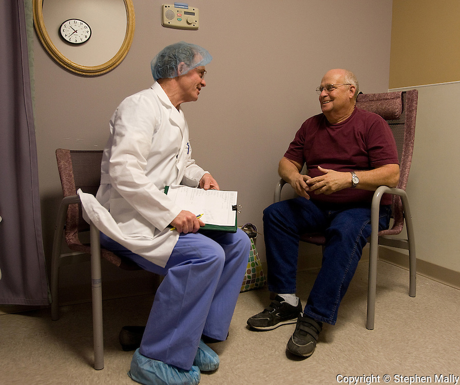 Dr. John Phillips (from left) talks with Richard Wilson after finishing a successful surgery on his wife, Jane Wilson, at Great River Medical Center in West Burlington, Iowa on Monday December 22, 2008.