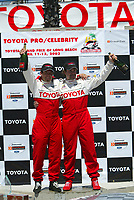 Apr 12, 2003; Long Beach, CA, USA; Pro Category Winner JEREMY McGRATH with overall race winner PETER RECKELL together with Champaigne bottles @ the 27th Annual Pro/Celebrity Race in Long Beach racing Toyota Celica race cars.  Driving 10 laps on a 1.97 mile track along shoreline drive. <br />