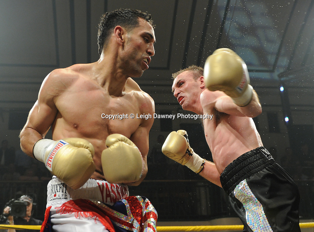 Yassine El Maachi (red/white shorts) defeats Colin Lynes in the semi final at Prizefighter Welterweights II,York Hall, Bethnal Green ,London. 07.06.11. Matchroom Sport/Prizefighter.Photo credit: Leigh Dawney 2011