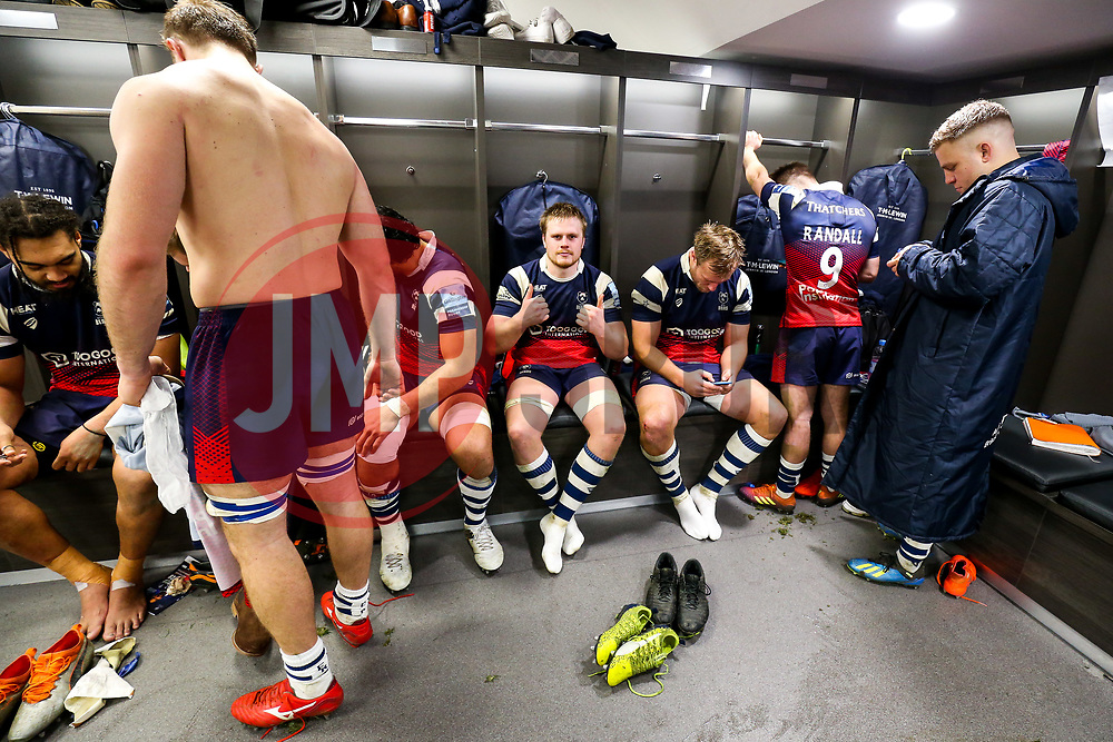 Dan Thomas looks on as Bristol Bears celebrate in the dressing room after Bristol Bears win 35-28 - Rogan/JMP - 30/12/2018 - RUGBY UNION - Ashton Gate Stadium - Bristol, England - Bristol Bears v Newcastle Falcons - Gallagher Premiership Rugby.