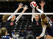 Coppell's Mary-Kate Marshall (15) and Cassidy Pickrell (4) block a Houston Clear Lake spike in the Class 5A semi-finals at the Curtis Culwell Center in Garland, Texas, on November 16, 2012.  (Stan Olszewski/The Dallas Morning News)
