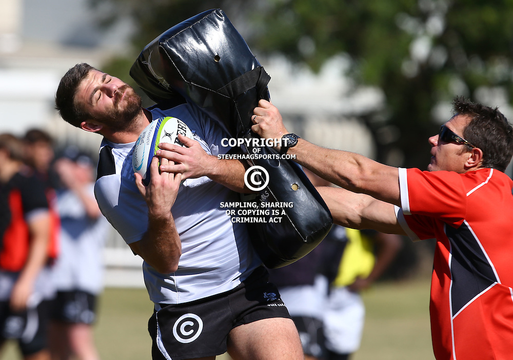 DURBAN, SOUTH AFRICA, 18,JULY, 2016 - Willie le Roux with Ryan Strudwick (Assistant Coach) of the Cell C Sharks during The Cell C Sharks training session at Growthpoint Kings Park in Durban, South Africa. (Photo by Steve Haag)<br /> <br /> images for social media must have consent from Steve Haag